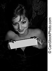 Sexy young adult woman in lingerie holds whiteboard -...