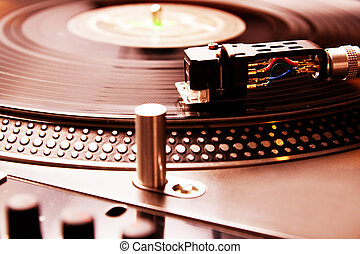 Turntable playing vinyl record with music - Close shot of...