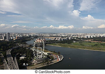 Aerial view of City of Singapore (Eastern part). Racing track is in view.