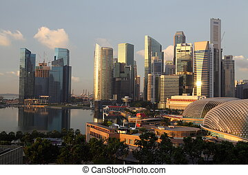 Sunrise over Downtown Skyline Singapore. Many skyscrappers...
