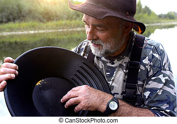 prospector panning for gold in rivers in France in the Gard...