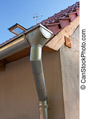 Groove, pipe and roof of a new residence
