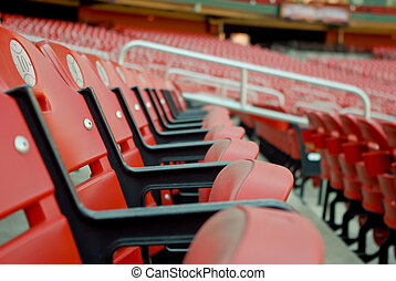 A Row of Red Stadium Seats - A photo of a row of stadium...