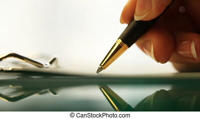 HD: extreme close-up of a pen and a