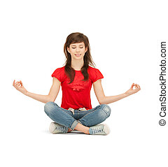 happy and carefree teenage girl in lotus pose - bright...