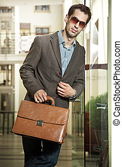 Young handsome businessman posing