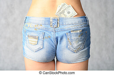 striptiase concept - money in the sexy jeans shorts