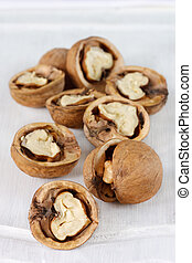 Chopped walnuts - Scattering choped garden walnuts on a...
