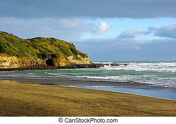 A Peninsula at Muriwai Beach - A coastal peninsula at...