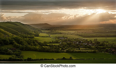 Lovely landscape of countryside hills and valleys with...