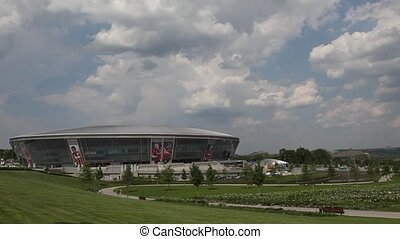 Football stadium in the background moving clouds. Donbass...