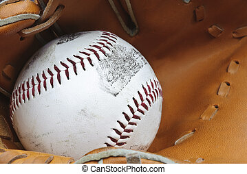 Macro shot of baseball in glove with shallow depth of field...