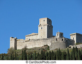 An ancient castle on a hillside in Assisi, Italy.