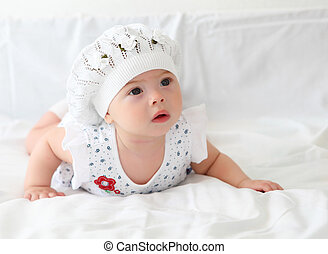 infant baby in a hat - portrait of an infant baby girl...