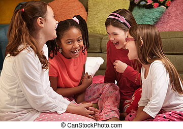 Happy Little Girls - Group of four little girls in pajamas...