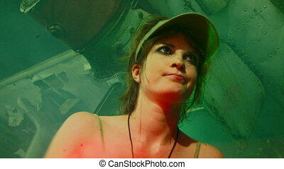 Love of music - Beautiful girl in a cap sits and plays...