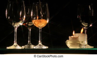 HD: pouring white wine in the glasses, candles