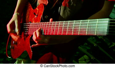 Electric guitar - Beautiful girl emotionally plays guitar....