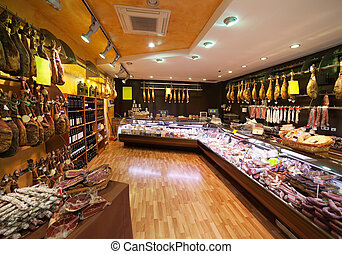 Meat at spanish market with hammon and sausages