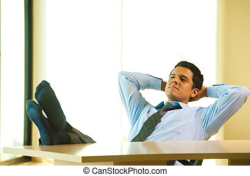 Hispanic Male Hands Behind Head Reclining - A successful...