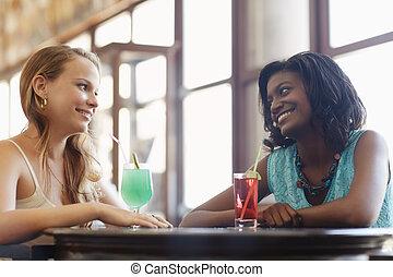 two women having fun in pub