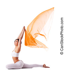 Young woman in yoga pose and flying fabric - Young woman in...