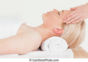 Pretty blonde woman enjoying her treatment in a Spa centre -...