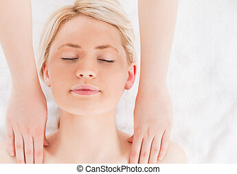Young blond-haired woman having a massage