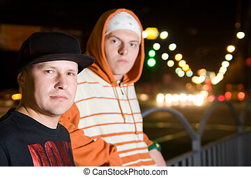 Rapper guys on the street at night - Fashionable young men...