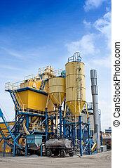 Cement factory with yellow silos