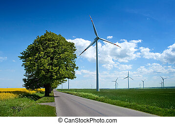 summer landscape with windmills - Wind turbines farm near...