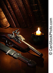 Ancient Weapon - Lighting candle near ancient pistol and...