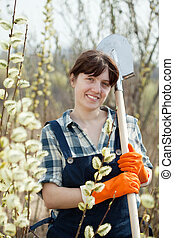 Female farmer with shovel in spring outdoor