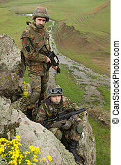 Soldiers in ammunitionon the cliff