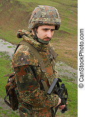 Portrait of soldier with a rifle