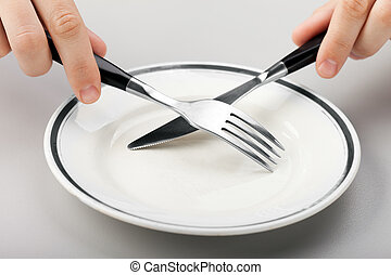 Hand holding fork and knife - Hungry person hand holding...