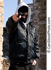 Criminal pointing with a gun - Armed robber pointing at you...
