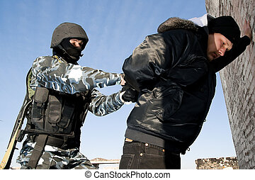 Soldier taking a criminal under arrest