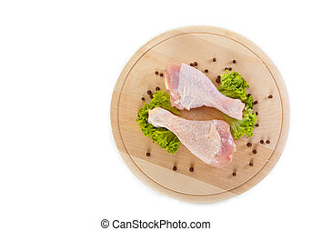 Fresh raw chicken legs with green salad