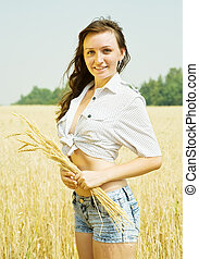 Girl at wheat field - Girl with wheat ears at wheat field in...
