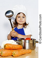 Smiling Girl in Cook's Cap Preparing Food - Young Smiling...