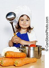 Smiling Girl in Cook's Cap Preparing Food - Young Smiling...