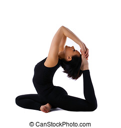 Yong woman sit in yoga asana - pigeon pose - young woman...