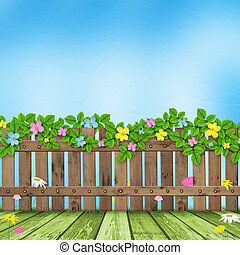 Wooden fence with a flower garland on the background of a...