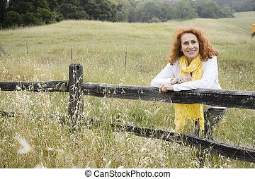 Senior Woman Outdoors - Pretty Redhead Senior Outdoors in...