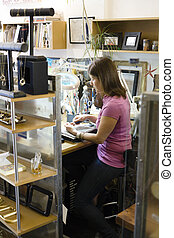 Woman at Workbench - Young Woman Jeweller Sitting at...