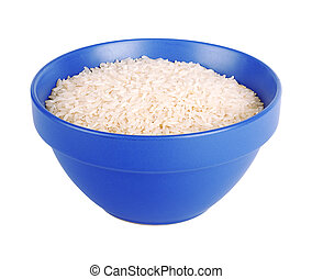 Uncooked basmati rice in a ceramic blue bowl on white...