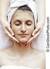 face massage - pretty woman receiving face massage, closeup...