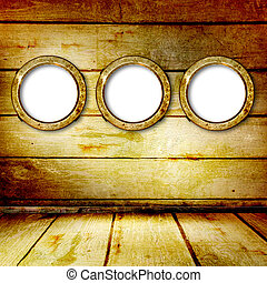 Grunge portholes on the ancient wooden background