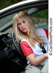 Pretty girl in car - Beautiful blonde female sitting in a...